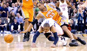 photo - Oklahoma City's Russell Westbrook (0) and Phoenix's Grant Hill (33) scramble for a loose ball during the NBA basketball game between the Oklahoma City Thunder and the Phoenix Suns, Sunday, March 6, 2011, the Oklahoma City Arena. Photo by Sarah Phipps, The Oklahoman