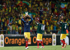 photo - Ethiopia's Addis Hintsa, left, and his teammates applaud the supporters at the end of their African Cup of Nations group C match with Nigeria Tuesday, Jan. 29 2013 at the Royal Bafokeng stadium in Rustenburg, South Africa. Hintasa had to replace goalkeeper goalkeeper Sisay Bancha in the goal after he was expelled. Nigeria defeated Ethiopia 2-0.  (AP Photo/Armando Franca)