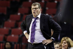 Photo - Connecticut coach Geno Auriemma follows his team during the first half of a regional semifinal against BYU in the NCAA college basketball tournament in Lincoln, Neb., Saturday, March 29, 2014. (AP Photo/Nati Harnik)