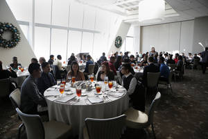 photo - Above: John Marshall High School students participate during a senior lunch Thursday at Vast in the Devon Tower in Oklahoma City.
