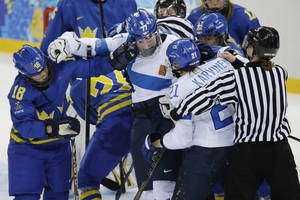 Photo - Members of Team Sweden and Team Finland mix it up during the 2014 Winter Olympics women's quarterfinal ice hockey game at Shayba Arena, Saturday, Feb. 15, 2014, in Sochi, Russia. (AP Photo/Matt Slocum)
