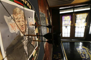 "photo - A photo of NFL commissioner Roger Goodell is seen on a dartboard inside the Parkview Tavern in New Orleans, Friday, Jan. 25, 2013. New Orleans is celebrating the return of coach Sean Payton after a season's NFL banishment as a result of the ""Bountygate"" scandal. But the good feeling does not extend to Goodell, who suspended Payton and other key players and coaches last year in the alleged pay-for-pain scheme. He is being ridiculed here with a vehemence usually reserved for the city's multitude of scandal-scarred politicians.(AP Photo/Gerald Herbert)"
