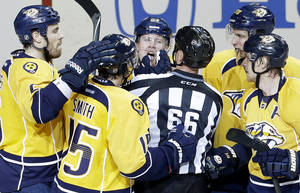 photo - Linesman Darren Gibbs (66) checks on Nashville Predators right wing Patric Hornqvist, of Sweden, top center, after Hornqvist was hit in the face while scoring a goal against the Dallas Stars in the second period of an NHL hockey game on Monday, Feb. 25, 2013, in Nashville, Tenn. (AP Photo/Mark Humphrey)