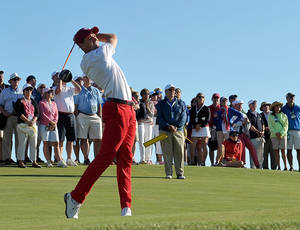 Photo - FILE - In this Sept. 7, 2013 file photo, Patrick Rodgers tees off on the third hole during the Walker Cup Match golf tournament held at the National Golf Links of America in Southampton, N.Y. Stanford junior Patrick Rodgers, the No. 1 ranked amateur in the world, says he will forgo his final year of eligibility to pursue a professional career after this season. Rodgers said in a statement issued through the school Monday, March 3, 2014, that he announced his decision now because he doesn't want the growing speculation about his future to become a distraction for the team.  (AP Photo/Kathy Kmonicek, File)