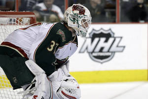 photo - FILE - This Jan. 17, 2012 file photo shows Minnesota Wild goalie Josh Harding (37) during an NHL hockey game against the Philadelphia Flyers in Philadelphia. Harding has been diagnosed with multiple sclerosis. The Wild confirmed Thursday, Nov. 29, 2012 that Harding is undergoing treatment for the disease, which attacks the body's immune system and affects the central nervous system. The Star Tribune first reported the news. (AP Photo/Matt Slocum, File)