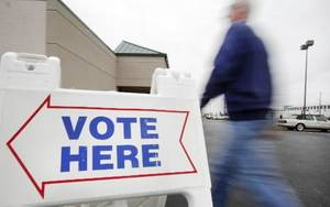 Photo - An Oklahoma county resident arrives for early voting at the Oklahoma County Election Board in Oklahoma City Nov. 1. Photo by Steve Gooch