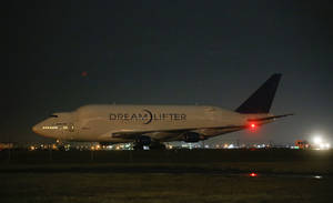 Photo - A Boeing 747 LCF Dreamlifter  sits on the runway after accidentally landing at Col. James Jabara Airport in Wichita, Kan. Wednesday night Nov. 20, 2013. Boeing says the Dreamlifter landed safely at Jabara, about eight miles from McConnell Air Force Base in Wichita where it was supposed to land. (AP Photo/Wichita Eagle, Jaime Green)