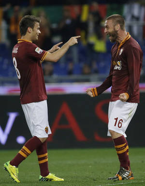Photo - Roma's Adem Liajic, left, celebrates with teammate Daniele De Rossi after scoring during a Serie A soccer match between Roma and Atalanta at Rome's Olympic stadium, Saturday, April 12, 2014. (AP Photo/Gregorio Borgia)