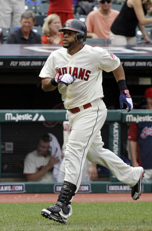 Photo -   Cleveland Indians' Carlos Santana jogs home after a two-run home run in the third inning of a baseball game against the Texas Rangers Sunday, Sept. 2, 2012, in Cleveland. Santana doubled in the eighth and scored on Thomas Neal's double, but the Indians lost 8-3. (AP Photo/Mark Duncan)