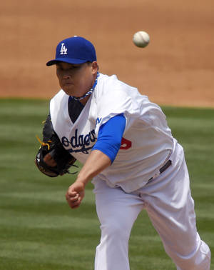 Photo - Los Angeles Dodgers starting pitcher Ryu Hyun-Jin, of South Korea, throws to the plate during the second inning of a baseball game against the Colorado Rockies, Sunday, April 27, 2014, in Los Angeles. (AP Photo/Mark J. Terrill)
