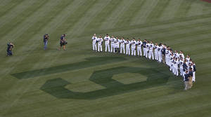 Photo - San Diego Padres players stand in right field observing 19 seconds of silence in honor of Hall of Fame player Tony Gwynn during ceremonies prior to a baseball game against the Seattle Mariners Wednesday, June 18, 2014, in San Diego. Gwynn died Monday of cancer at the age of 54.  (AP Photo/Lenny Ignelzi)
