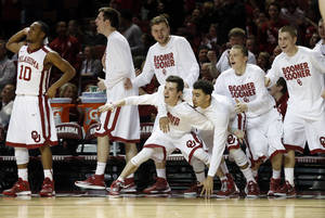 Photo - The Sooner bench reacts to play in the second half as the University of Oklahoma Sooners (OU) men defeat the Texas Longhorns (TU) 77-65 in NCAA, college basketball at The Lloyd Noble Center on Saturday, March 1, 2014  in Norman, Okla. Photo by Steve Sisney, The Oklahoman