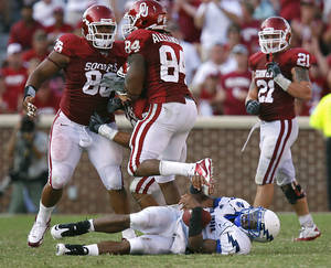 Photo - Oklahoma's Adrian Taylor (86) and Frank Alexander (84) celebrate after a sack on Air Force's Tim Jefferson (7) during the second half of the college football game between the University of Oklahoma Sooners (OU) and the Air Force Falcons at the Gaylord Family - Memorial Stadium on Saturday, Sept. 18, 2010, in Norman, Okla.   Photo by Chris Landsberger, The Oklahoman