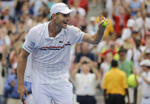 Photo -   Andy Roddick celebrates after beating Italy's Fabio Fognini in the third round of play at the 2012 US Open tennis tournament, Sunday, Sept. 2, 2012, in New York. (AP Photo/Mike Groll)