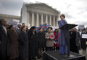 photo - House Minority Leader Nancy Pelosi of Calif.,speaks during a rally outside the Supreme Court in Washington, Wednesday, Feb. 27, 2013, before arguments in the Shelby County, Ala., v. Holder voting rights case. The justices are hearing arguments in a challenge to the part of the Voting Rights Act that forces places with a history of discrimination, mainly in the Deep South, to get approval before they make any change in the way elections are held. (AP Photo/Evan Vucci)