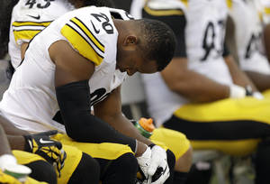 Photo - Pittsburgh Steelers strong safety Will Allen sits on the bench during the fourth quarter of an NFL football game against the Oakland Raiders in Oakland, Calif., Sunday, Oct. 27, 2013. The Raiders won 21-18. (AP Photo/Ben Margot)