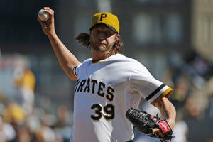 Photo - Pittsburgh Pirates relief pitcher Jason Grilli (39) delivers during the ninth inning of a baseball game against the Milwaukee Brewers in Pittsburgh Sunday, April 20, 2014. The Brewers won in 14 innings 3-2. (AP Photo/Gene J. Puskar)