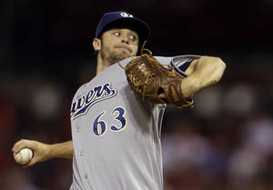 Photo - Milwaukee Brewers starting pitcher Tyler Thornburg throws during the first inning of a baseball game against the St. Louis Cardinals, Thursday, Sept. 12, 2013, in St. Louis. (AP Photo/Jeff Roberson)