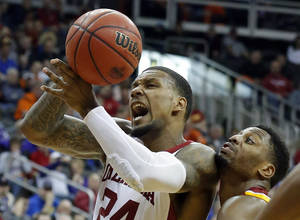 photo - BIG 12 TOURNAMENT / OU COLLEGE BASKETBALL: Oklahoma's Romero Osby (24) tries to hang on to the ball as Iowa State's Melvin Ejim (3) defends during the Phillips 66 Big 12 Men's basketball championship tournament game between the University of Oklahoma and Iowa State at the Sprint Center in Kansas City, Thursday, March 14, 2013. Photo by Sarah Phipps, The Oklahoman