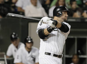 photo -   Chicago White Sox's A.J. Pierzynski watches his RBI single during the seventh inning of a baseball game against the Oakland Athletics in Chicago, Saturday, Aug. 11, 2012. (AP Photo/Nam Y. Huh)