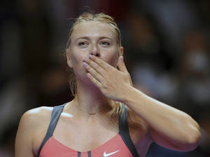 Photo -   Maria Sharapova of Russia blows a kiss to spectators after winning her tennis match against Samantha Stosur of Australia on the fourth day of the WTA championship in Istanbul, Turkey, Friday, Oct. 26, 2012. (AP Photo)