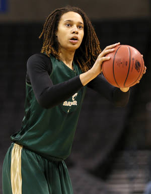 Photo - Baylor's Brittney Griner (42) takes a shot during the press conference and practice day at the Oklahoma City Regional for the NCAA women's college basketball tournament at Chesapeake Energy Arena in Oklahoma City, Saturday, March 30, 2013. Photo by Nate Billings, The Oklahoman