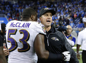 Photo - Baltimore Ravens head coach John Harbaugh hugs inside linebacker Jameel McClain after their 18-16 win over the Detroit Lions in an NFL football game in Detroit, Monday, Dec. 16, 2013. (AP Photo/Rick Osentoski)