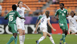 photo -   CORRECTS NAME OF OSHOALA - Morgan Brian (6) of the U.S., celebrates with teammates Kelly Cobb (20) and Maya Hayes (5), after scoring her team's first goal against Nigeria during their semifinal soccer match of the U-20 women's World Cup in Tokyo, Tuesday, Sept. 4, 2012. Nigeria's players are Josephine Chukwunonye (15) and Asisat Oshoala (14). (AP Photo/Shizuo Kambayashi)