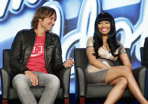 photo - CORRECTS DAY AND DATE  - Keith Urban and Nicki Minaj from &quot;American Idol&quot; attend the Fox Winter TCA Tour at the Langham Huntington Hotel on Tuesday, Jan. 8, 2013, in Pasadena, Calif. (Photo by Todd Williamson/Invision/AP)
