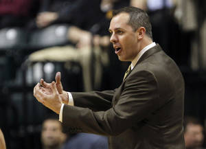 Photo -   FILE - This Feb. 28, 2012 file photo shows Indiana Pacers coach Frank Vogel gesturing during the third quarter of an NBA basketball game against the Golden State Warriors, in Indianapolis. Vogel took over the Pacers in the middle of last season and took a struggling team to the playoffs. (AP Photo/Dave Martin, File)