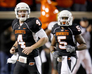 Photo - OSU's Brandon Weeden walks back to the sidelines during last year's game against Colorado. Photo by Bryan Terry, The Oklahoman Archive