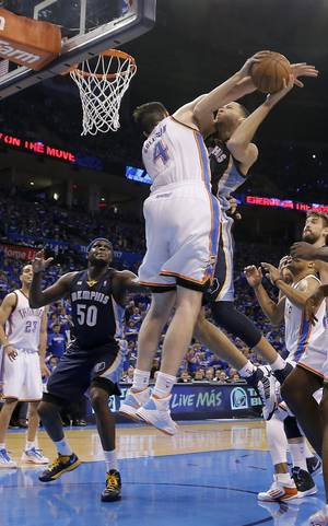 Photo - Oklahoma City's Nick Collison (4) fouls Memphis' Tayshaun Prince (21) during the second round NBA playoff basketball game between the Oklahoma City Thunder and the Memphis Grizzlies at Chesapeake Energy Arena in Oklahoma City, Sunday, May 5, 2013. Photo by Chris Landsberger, The Oklahoman