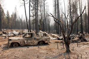 photo -   A damaged truck sits among other remains, Wednesday, Aug. 22, 2012, at a rural house site outside Manton, Calif., where a huge wildfire burned through on Saturday, forcing residents to evacuate. The Ponderosa Fire, which has scorched about 38 square miles, was 50 percent contained Wednesday morning, according to the California Department of Forestry and Fire Protection. The threat to homes about 35 miles east of Redding has dropped from 3,500 earlier this week to roughly 200 residences. (AP Photo/Jeff Barnard)