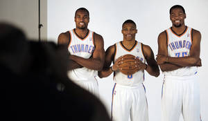 Photo - Serge Ibaka, Russell Westbrook and Kevin Durant pose for photos during media day with the Oklahoma City Thunder in Oklahoma City, Thursday September  27, 2013. Photo By Steve Gooch, The Oklahoman