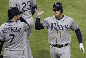 Photo -   Tampa Bay Rays' Evan Longoria, right, celebrates with Jeff Keppinger after hitting a solo home run against the Chicago White Sox during the ninth inning of a baseball game in Chicago, Thursday, Sept. 27, 2012. The Rays won 3-2. (AP Photo/Nam Y. Huh)