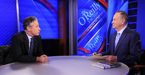 """Photo -   FILE - This Sept. 22, 2010 file photo shows Comedy Central's Jon Stewart from """"The Daily Show with Jon Stewart,"""" left, and and political pundit Bill O'Reilly during an interview for """"The O'Reilly Factor"""" on FOX News Channel, in New York. O'Reilly and Jon Stewart face off for a special 90-minute debate about the 2012 presidential race. The live debate will be streamed online on Oct. 6, 2012 from George Washington University in Washington, D.C. The price is $4.95, with one-half of the profits donated to a number of unspecified charities. (AP Photo/Peter Kramer, file)"""