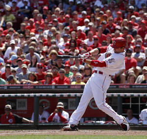 Photo - Cincinnati Reds' Joey Votto hits the go ahead two-run home run off Cleveland Indians relief pitcher Nick Hagadone in the eighth inning during a baseball game, Monday, May 27, 2013, in Cincinnati. The Reds won 4-2. (AP Photo/David Kohl)