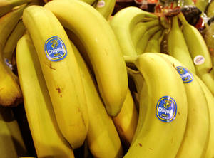 Photo - FILE - In this Aug. 3, 2005 file photo, Chiquita bananas are on display at a grocery store in Bainbridge, Ohio. Fruit supply companies Chiquita of the United States and Fyffes of Ireland said Monday, March 10, 2014, they had agreed to merge to create the world's biggest banana supplier. (AP Photo/Amy Sancetta, File)