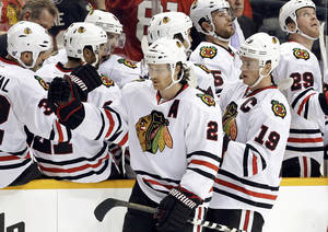 Photo - Chicago Blackhawks center Jonathan Toews (19) and Duncan Keith (2) celebrate after Toews scored against the Nashville Predators in the second period of an NHL hockey game, Sunday, Feb. 10, 2013, in Nashville, Tenn. (AP Photo/Mark Humphrey)