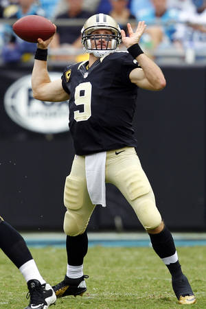 Photo -   New Orleans Saints quarterback Drew Brees (9) looks to pass against the Carolina Panthers during the third quarter of an NFL football game in Charlotte, N.C., Sunday, Sept. 16, 2012. (AP Photo/Chuck Burton)