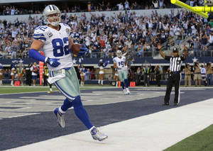 Photo - Dallas Cowboys tight end Jason Witten (82) scores a touchdown against the Pittsburgh Steelers during the first half of an NFL football game Sunday, Dec. 16, 2012 in Arlington, Texas. (AP Photo/LM Otero)