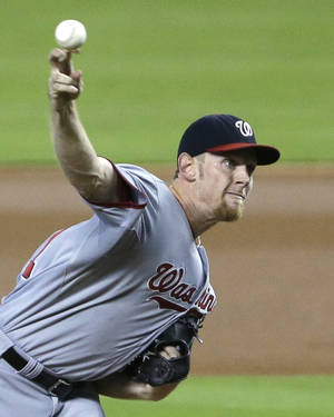 Photo - Washington Nationals' Stephen Strasburg delivers a pitch during the first inning of a baseball game against the Miami Marlins, Sunday, Sept. 8, 2013, in Miami. (AP Photo/Wilfredo Lee)