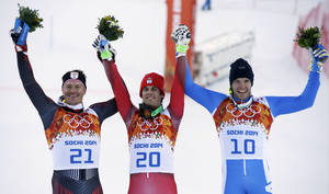 Photo - Men's supercombined medalists from left, Croatia's Ivica Kostelic (silver), Switzerland's Sandro Viletta (gold) and Italy's Christof Innerhofer (bronze) pose for photographers on the podium during a flower ceremony at the Alpine ski venue at the Sochi 2014 Winter Olympics, Friday, Feb. 14, 2014, in Krasnaya Polyana, Russia.(AP Photo/Christophe Ena)