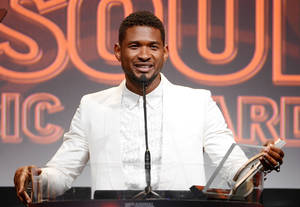 "Photo - FILE - In this June 27, 2013 file photo shows Usher accepts the golden note award at the 26th Annual ASCAP Rhythm & Soul Music Awards in Beverly Hills, Calif. Usher's ex-wife asked for an emergency custody hearing a day after one of the pair's sons nearly drowned in a pool at the singer's Atlanta home. A lawyer for Tameka Foster Raymond filed the request in Fulton County Superior Court on Tuesday, Aug. 6. The court filing says the boy ""suffered a near-death accident"" while left unsupervised in a pool at the Grammy winner's home. A judge has set a hearing for Friday. (AP Photo/ASCAP, Phil McCarten, File)"