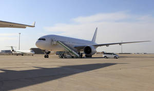 Photo - A Boeing 777 plane is seen after landing in Baghdad, Iraq, Saturday, Dec. 15, 2012. The first new Boeing jetliner sold to Iraq in years touched down in Baghdad on Saturday, signaling the country's determination to rebuild its economy after decades of war and sanctions. (AP Photo/Karim Kadim)