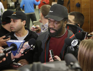 Photo - New York Jets' Ed Reed speaks to reporters in the locker room of the Jets training facility in Florham Park, N.J., Monday, Dec. 30, 2013. (AP Photo/Seth Wenig)