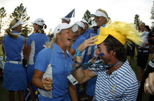 Photo - Europe's Caroline Hedwall, from Sweden, celebrates with fans after she and her teammates beat Team USA and clinched the Solheim Cup golf tournament, Sunday, Aug. 18, 2013, in Parker, Colo. (AP Photo/David Zalubowski)