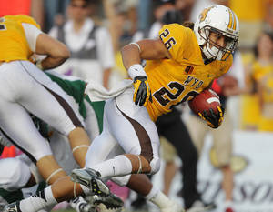 Photo -   Wyoming running back Shaun Wick rushes for a touchdown against Cal Poly during the fourth quarter of an NCAA college football game, Saturday, Sept. 15, 2012, in Laramie, Wyo. Cal Poly won 24-22. (AP Photo/The Wyoming Tribune Eagle, Michael Smith)
