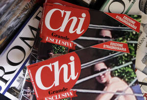 photo -   Copies of the Italian magazine Chi are displayed at a newstands in Rome, Monday, Sept. 17, 2012. An Italian gossip magazine owned by former Premier Silvio Berlusconi published a 26-page spread of topless photos of Prince William's wife Kate on Monday despite legal action in France against the French magazine that published them first. Chi hit newsstands on Monday, featuring a montage of photos taken while the Duke and Duchess of Cambridge were on vacation at a relative's home in the south of France last month. They included the 14 pictures published by the popular French magazine Closer, which like Chi is owned by Berlusconi's Mondadori publishing house. (AP Photo/Alessandra Tarantino)