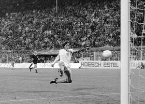Photo - FILE - In this July 3, 1974 file photo, Dutch forward Johann Cruyff scores his team's second goal against Brazil in their World Cup Soccer match, in Dortmund, West Germany. On this day: The Netherlands beats Brazil 2-0 to qualify for the World Cup final. (AP Photo, File)